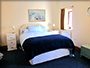 larkrises holidays camping - holiday cottage bedroom showing double bed