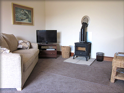 larkrises holidays camping - holiday cottage seating area